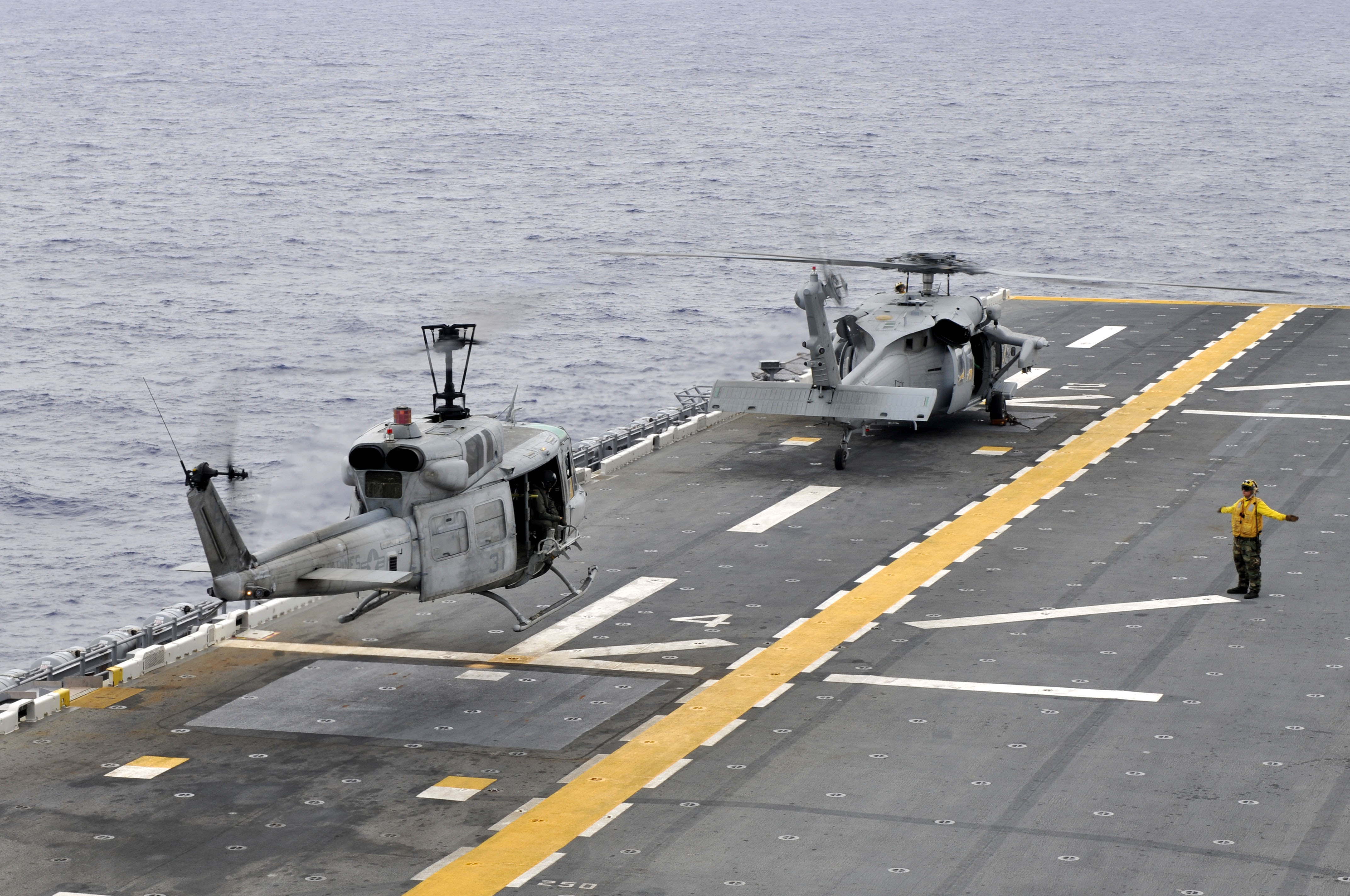 helicopter operations at sea with File Us Navy 111010 N Km175 074 A Uh 1n Huey Helicopter Assigned To The Marine Medium Helicopter Squadron  Hmm  265 Takes Off From The Forward Deployed on File US Navy 090826 N 4649B 094 An MH 53 Sea Dragon helicopter assigned to the Blackhawks of Helicopter Mine Countermeasures Squadron  HM  15 prepares to land on the multi Purpose  hibious assault ship USS Bataan  LHD 5 as well File Apache Helicopter Takes off from HMS Ocean During Operation Ellamy MOD 45153052 as well Fsx North Sea Scenery in addition Arma2 Operation Arrowhead as well Helideck Perimeter  ting.