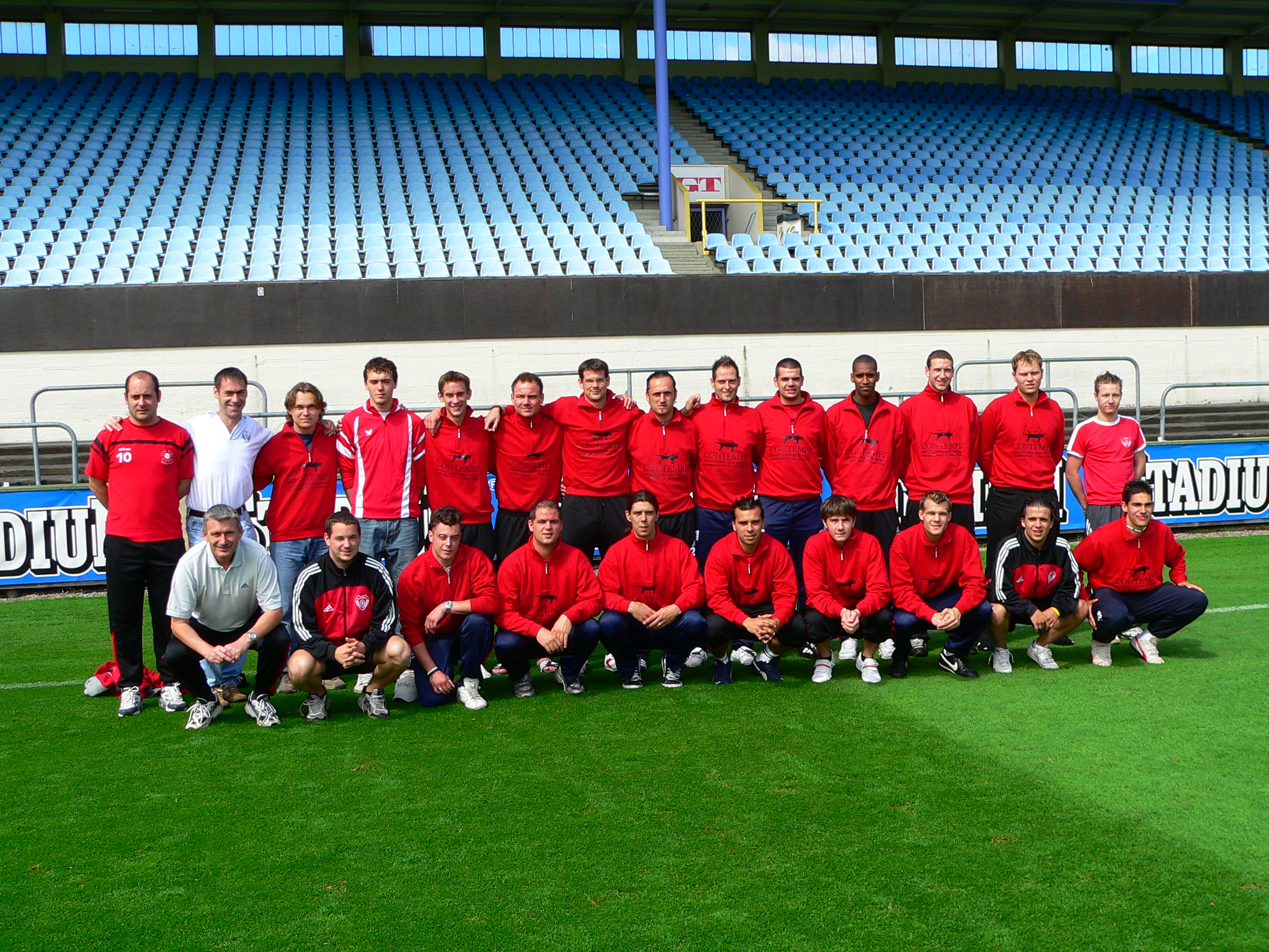 A Swedish football team group portrait on the grass in an empty stadium