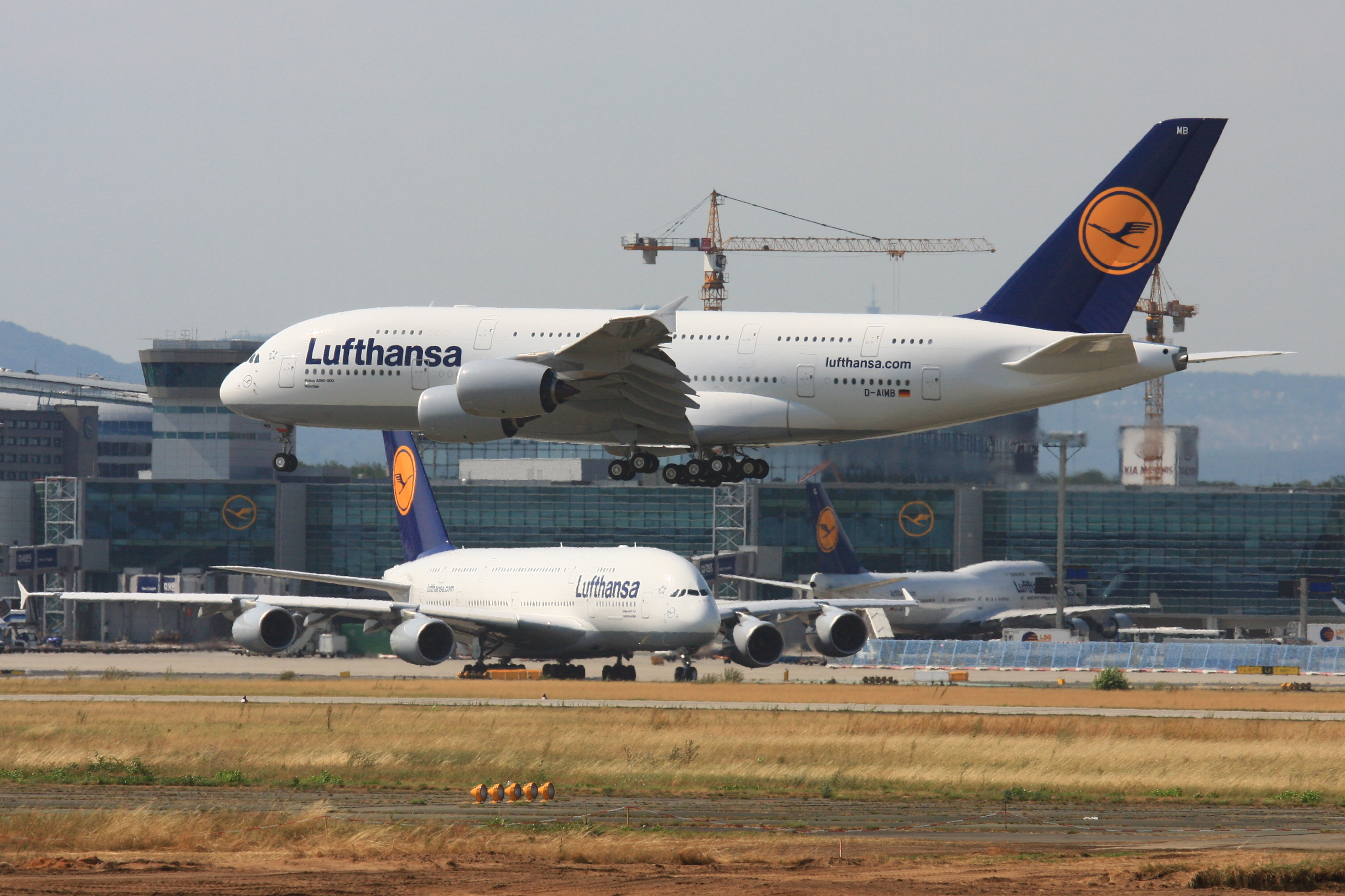 Two Airbus A380 and a Boeing 747 aircraft at F...