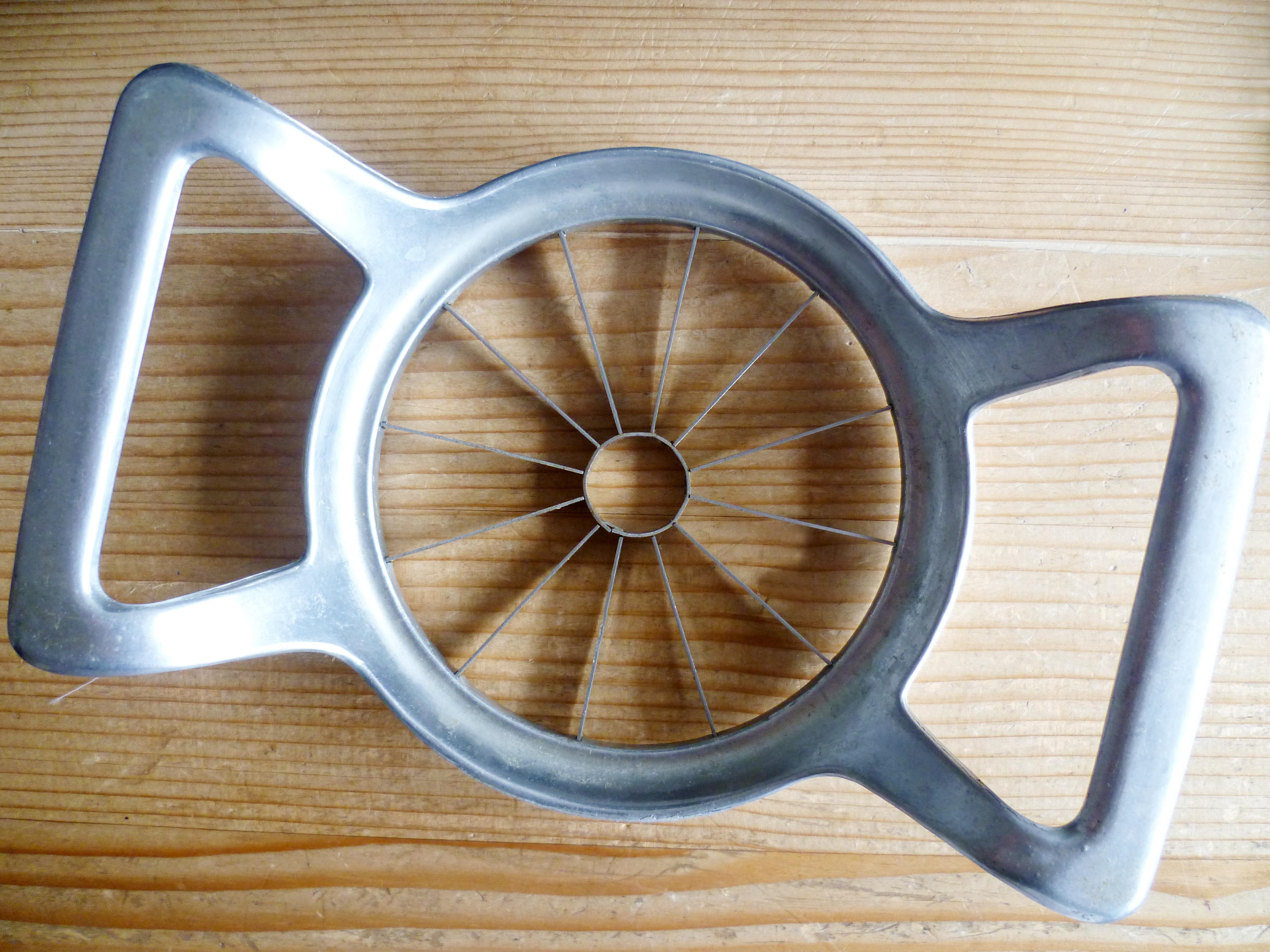 Apple slicer on wooden table