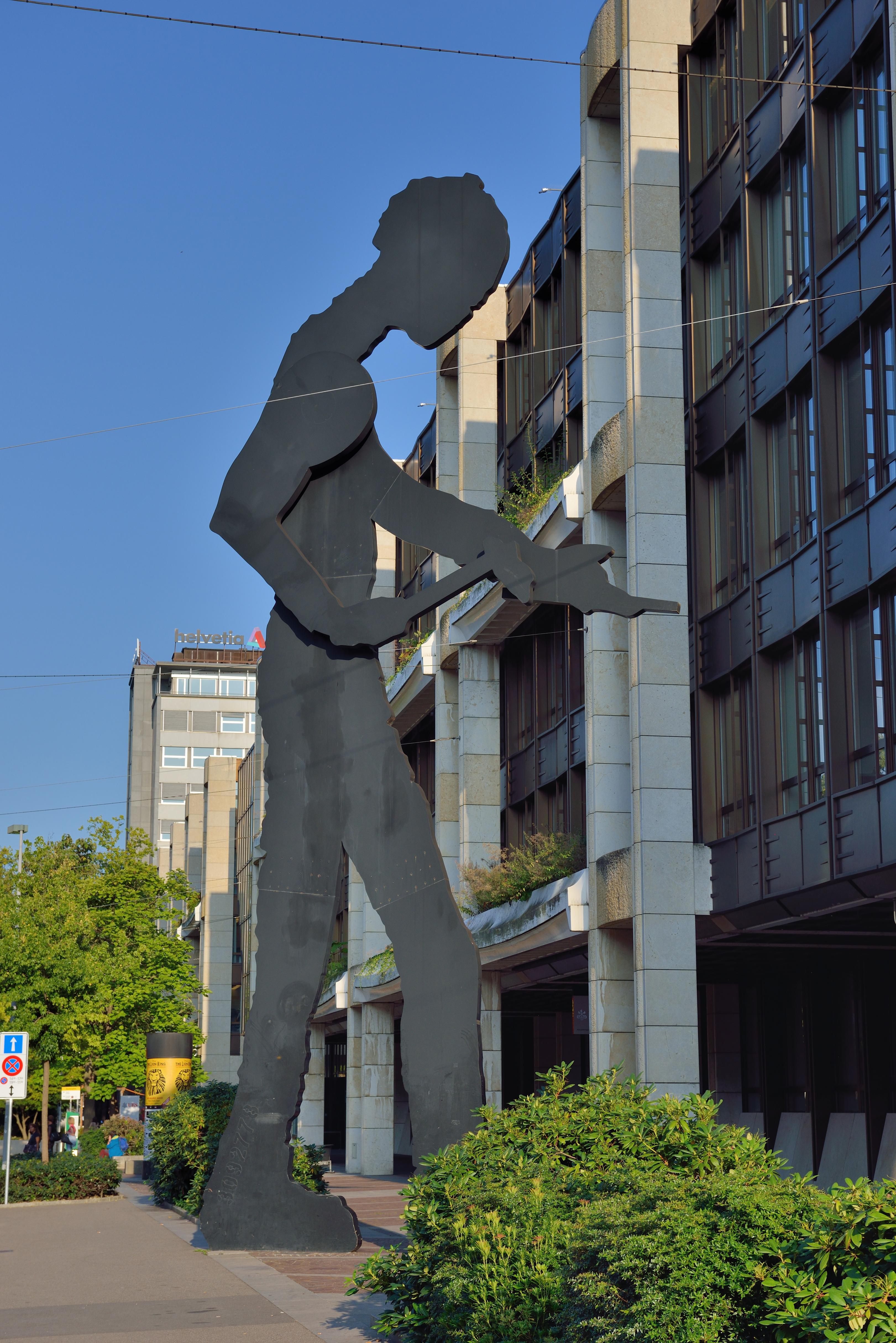 https://upload.wikimedia.org/wikipedia/commons/c/cd/Basel_-_Hammering_Man.jpg