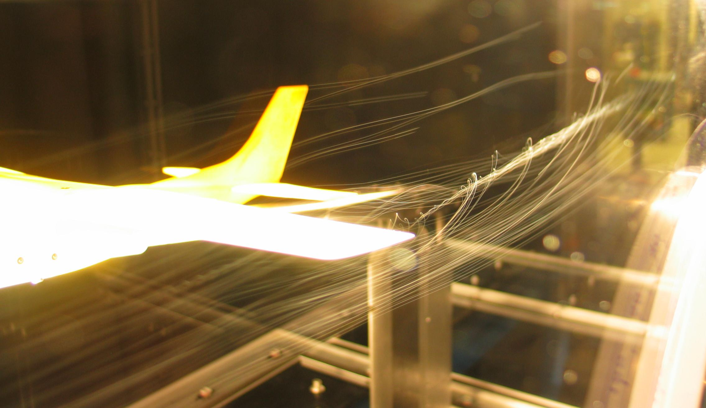 Plane model tested inside a wind tunnel.