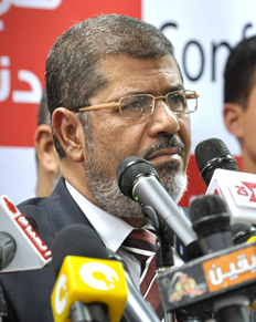 From http://commons.wikimedia.org/wiki/File:Mohamed_Morsi_cropped.png: Mohamed Morsi cropped