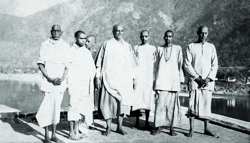 Swami Chinmayananda on his day of Sannyas initiation, with Guru Swami Sivananda and other disciples, Feb 25, 1949, Maha Shivratri Day