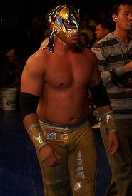 Volador Jr. walking to a wrestling ring at a live event