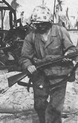 A United States Marine carrying a Winchester M97 shotgun during World War II