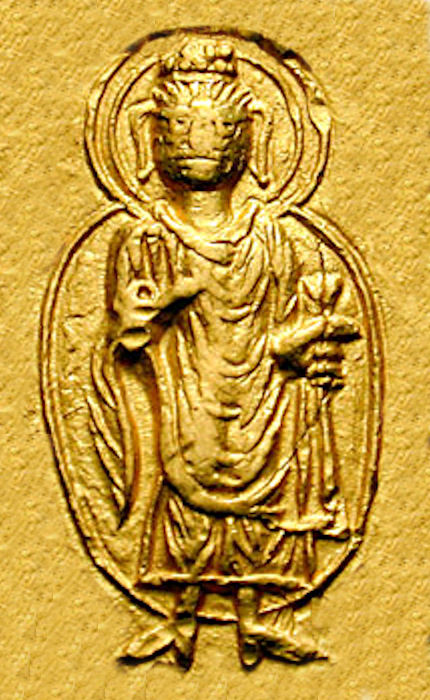 The Buddha on a coin of Kanishka I, c. 130 CE. Kanishka Buddha detail.jpg