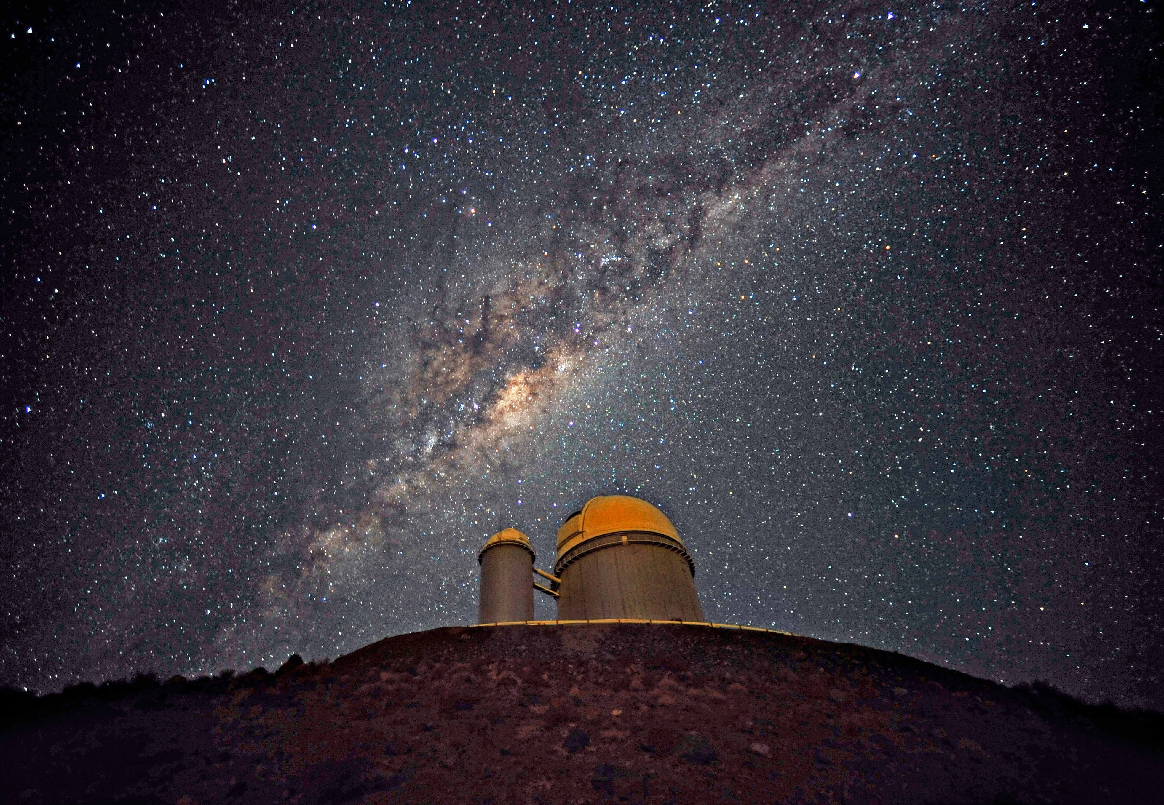The Milky Way above a huge telescope