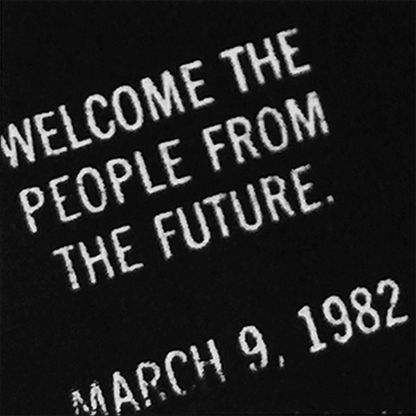 A sign, dated March 9, 1982, welcoming travelers from the future