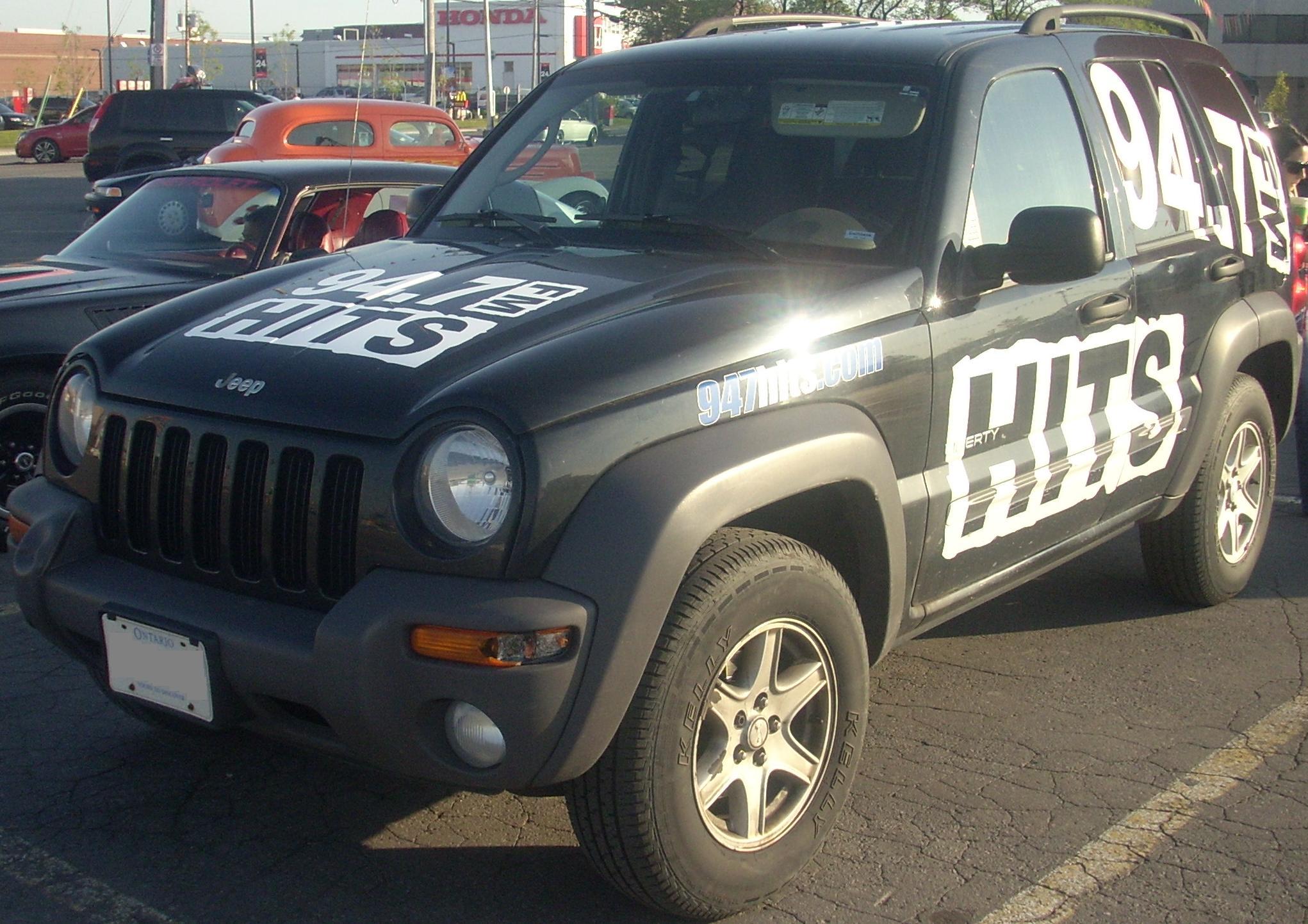 KJ Worldwide %2702-%2704_Jeep_Liberty_From_94.7_Hits_FM_(Orange_Julep)