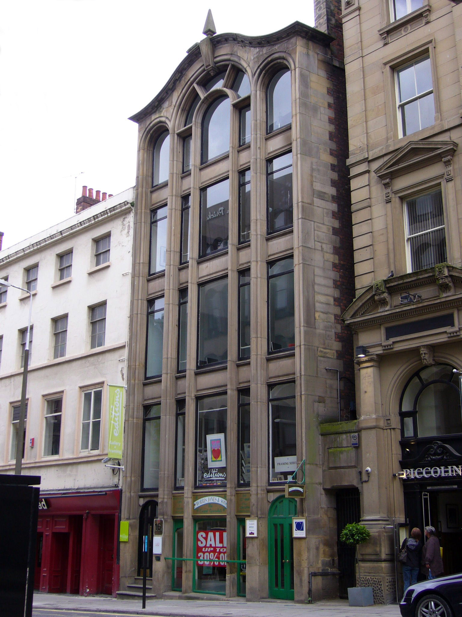 16 Cook Street, Liverpool, England,1866. Extensive use of floor to ceiling glass is used, enabling light penetration deeper into the building maximizing floor space.