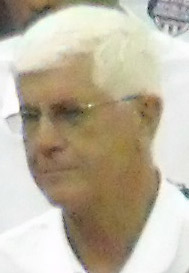 A white-haired man wearing glasses