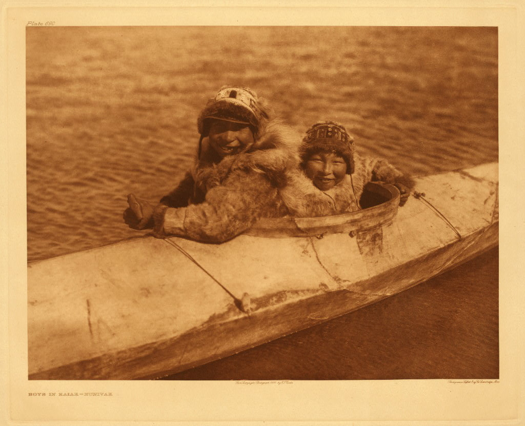 Two people in kayak, Nunivak, Alaska, photographed by Edward S. Curtis, 1930