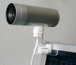 An iSight webcam mounted on a PowerBook G4.