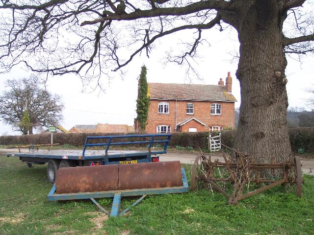 Ongers Farm. Viewed from the south-west with an interesting trio of farm equipment in the foreground.
