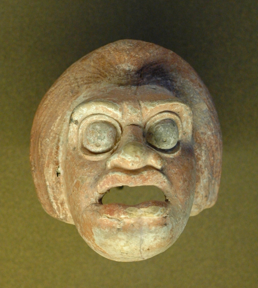 http://upload.wikimedia.org/wikipedia/commons/c/cf/Peasant_mask_Boeotia_Louvre_MNB506.jpg