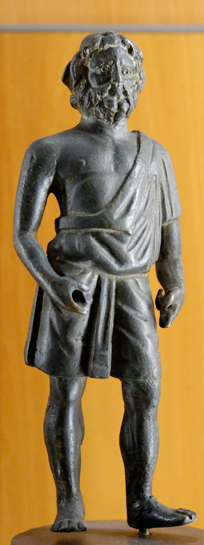 Vulcain portant la tunique et le bonnet conique des artisans, bronze romain du Iersiècle ap. J.-C., musée des Beaux-Arts de Lyon.