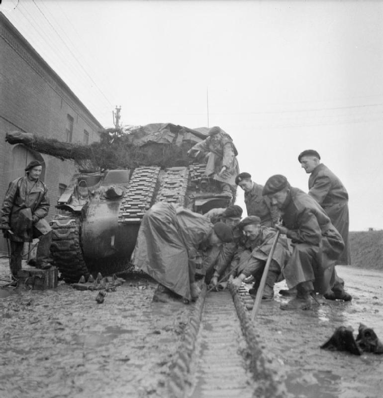 Repairing the track on a Sherman tank
