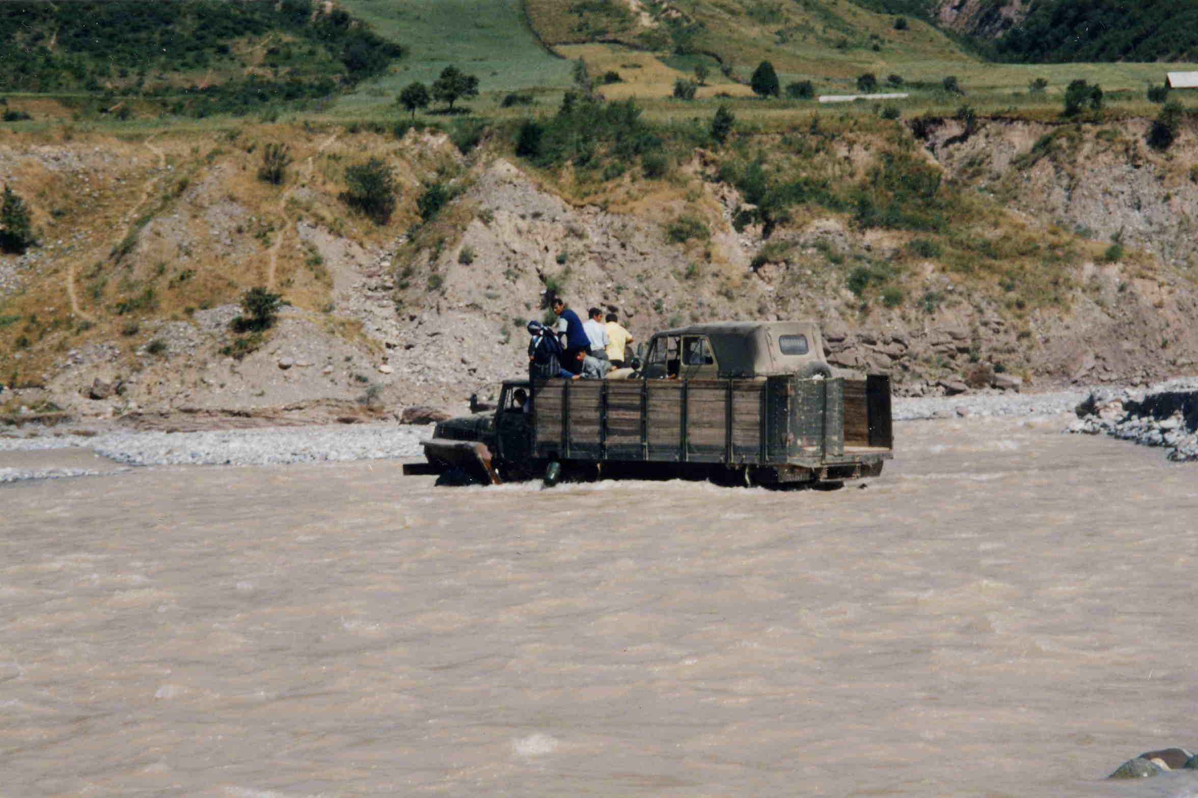 Ural 4320 truck fording a river with a uaz 469 in tajikistan 2