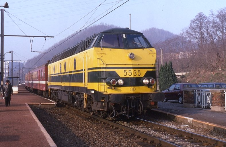 Belgian Railways class 55 is seen on a morning Peak (P) train at Herstal on 14 March 1995.