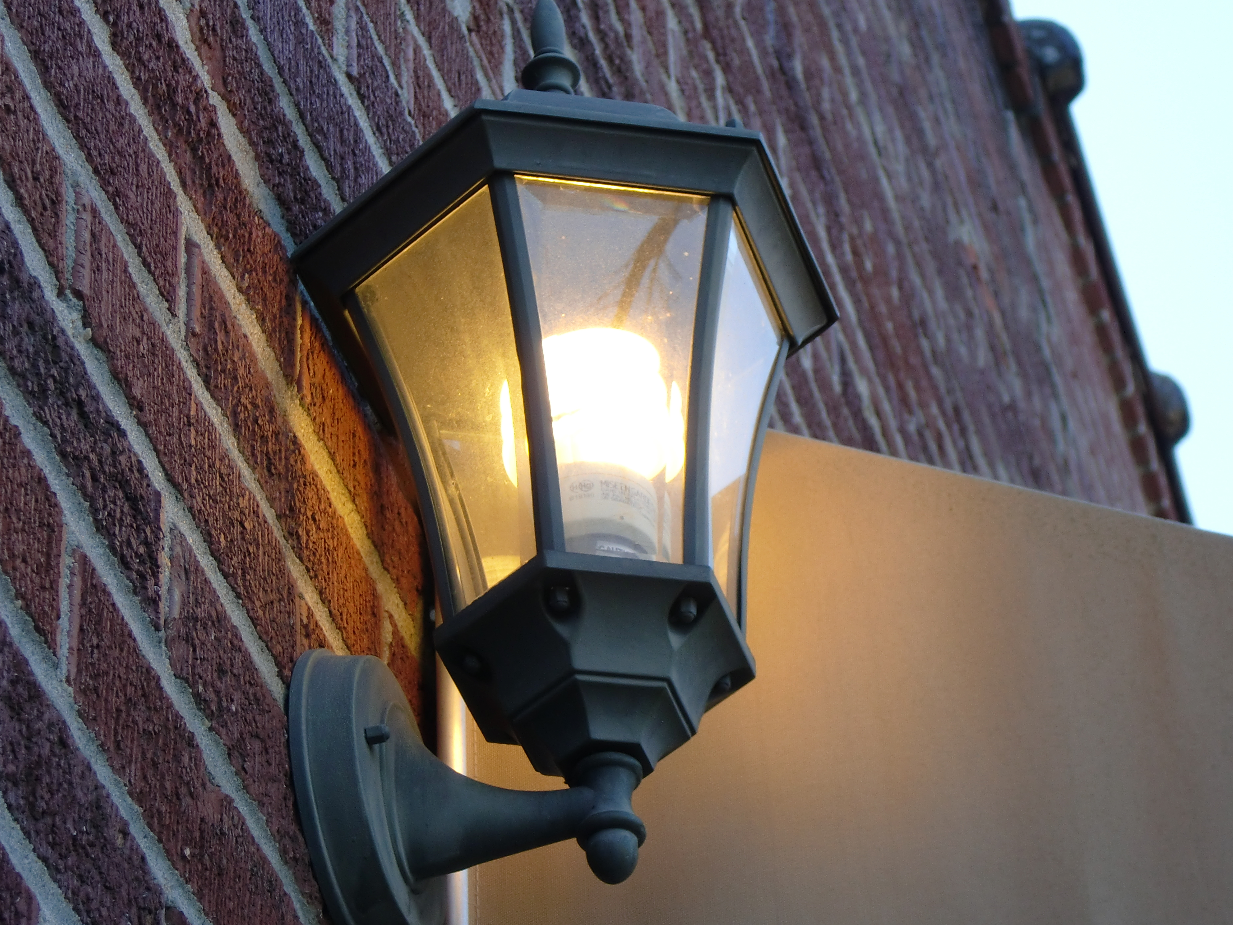 File:A CFL Light Bulb on a wall in a black lantern in South Carolina ...