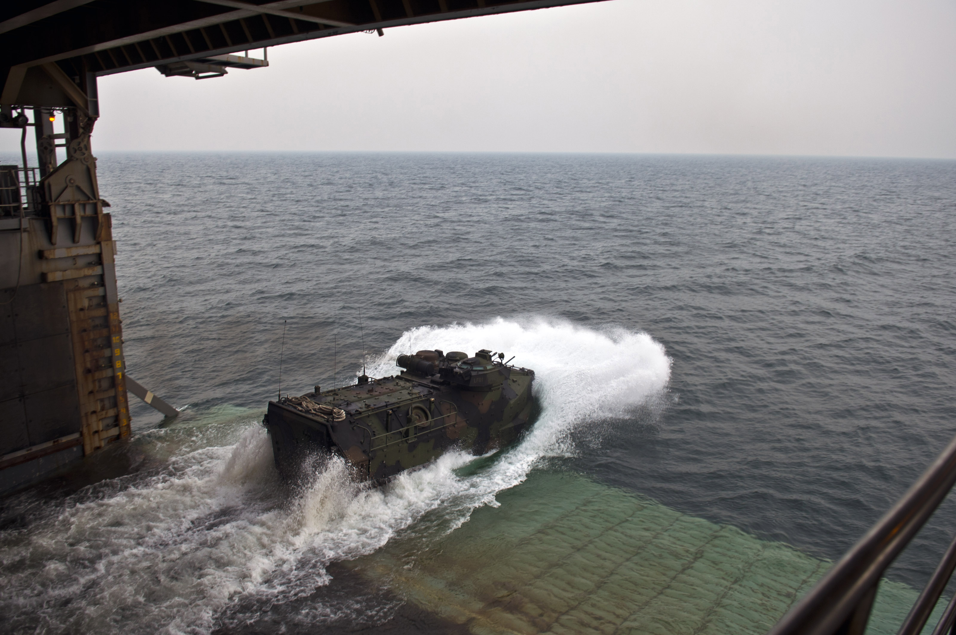 http://upload.wikimedia.org/wikipedia/commons/d/d0/A_U.S._Marine_Corps_assault_amphibious_vehicle_exits_the_well_deck_of_the_amphibious_dock_landing_ship_USS_Tortuga_(LSD_46)_to_participate_in_a_joint_exercise_with_the_Royal_Malaysian_Navy_June_21,_2013,_in_130621-N-IY633-007.jpg