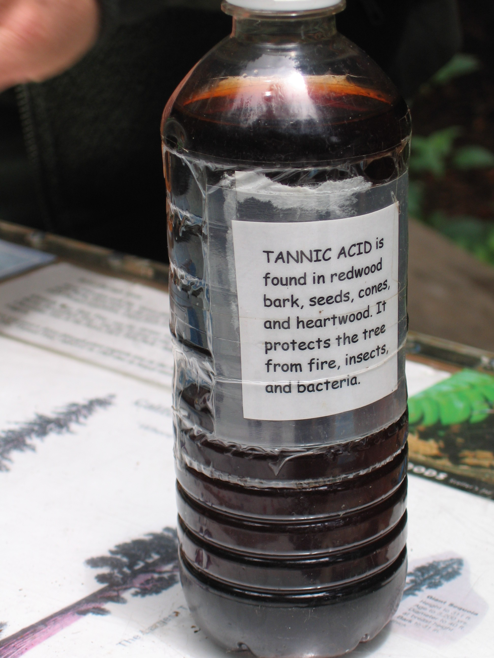 A bottle of tannic acid solution in water.