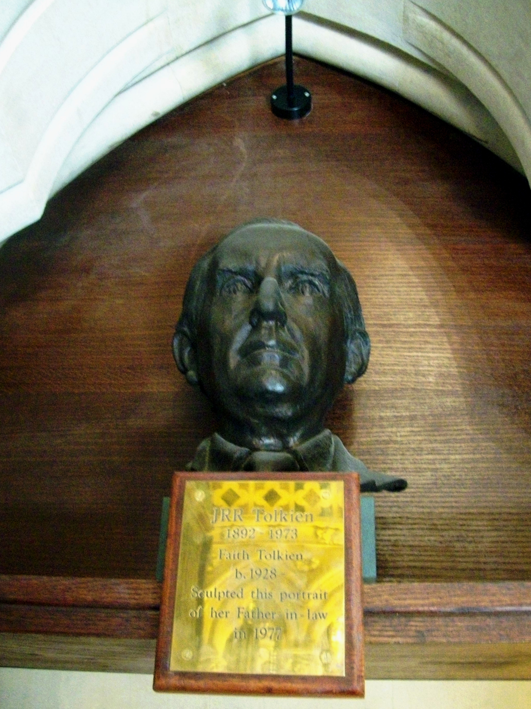 "This bust of the author JRR Tolkien is located high on the wall close to the entrance to Exeter Colege Chapel, Oxford. The inscription reads: JRR Tolkien 1892 - 1973 Faith Tolkien b.1928 Sculpted this portrait of her Father-in-law in 1977. Renowned for his high fantasy novels; The Hobbit & Lord of the Rings Tolkien graduated from Exeter College with a first class honours degree in English Language and Literature and became a Professor at Oxford's Pembroke College. He was a member of ""The Inklings"" as was his close friend C.S.Lewis."