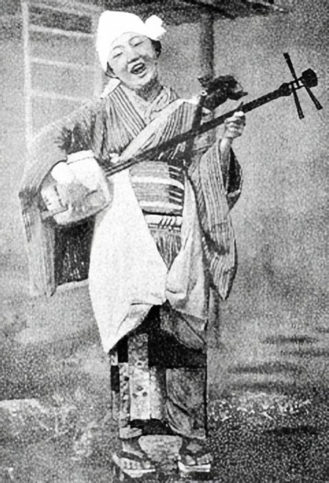 A Japanese folkswoman with her shamisen, 1904