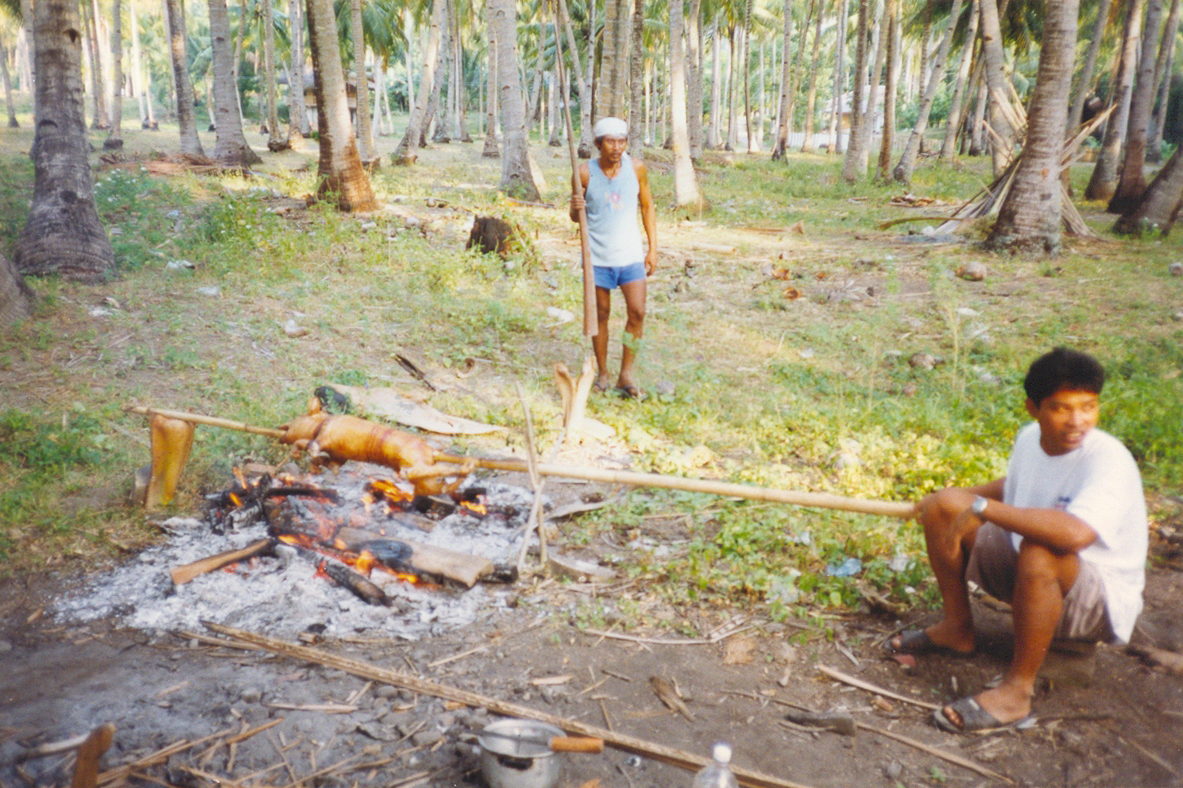 Lechon_Camiguin - Lechon prepared outside in nature - Philippine Photo Gallery