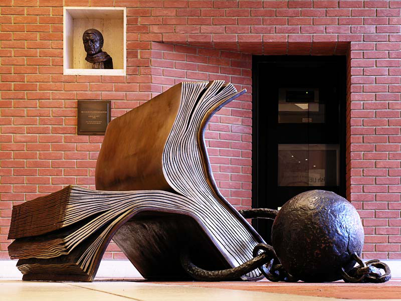 Sitting on History - a sculpture at the British Library, photographed by Senra (John McCullough).