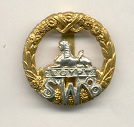 South Wales Borderers cap badge, showing the Sphinx.jpg