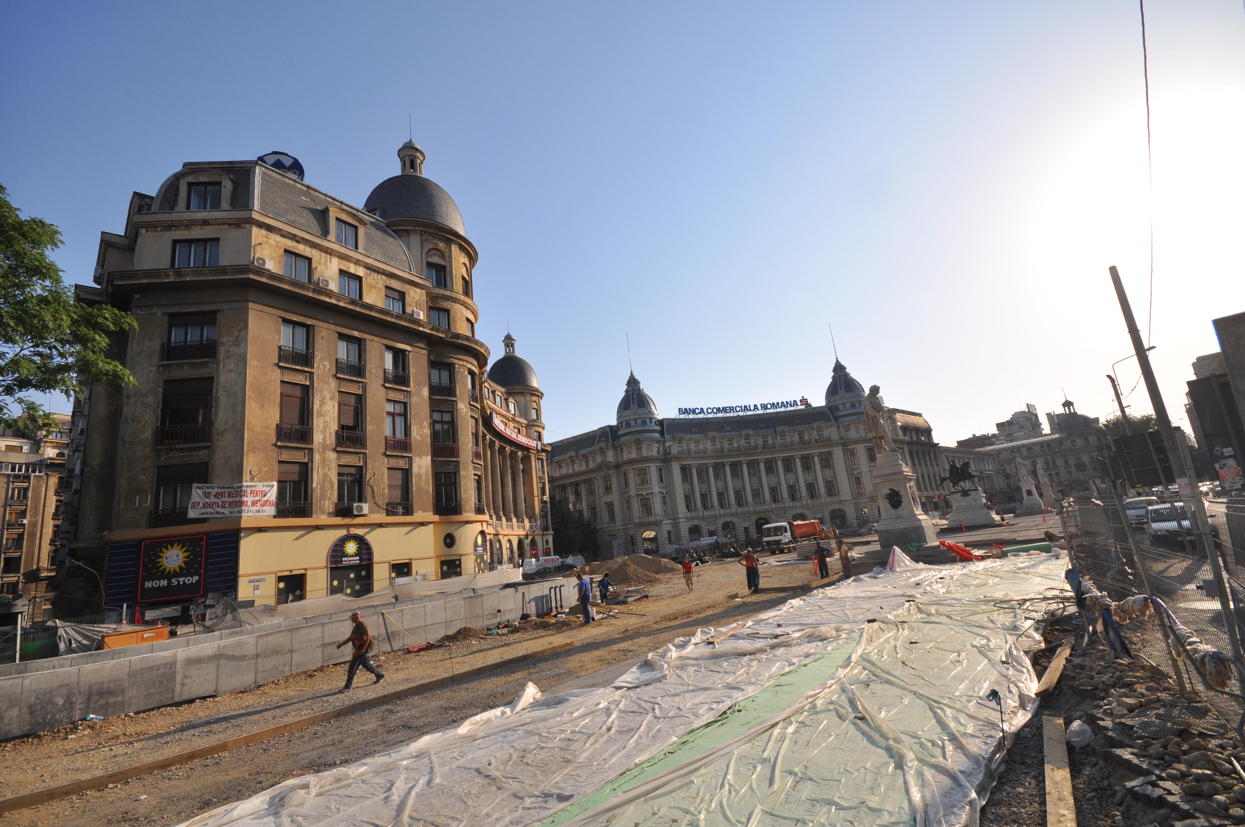 University Square being renovated (11320903943).jpg University Square (Romanian: Piaţa Universităţii) is located in downtown Bucharest, near