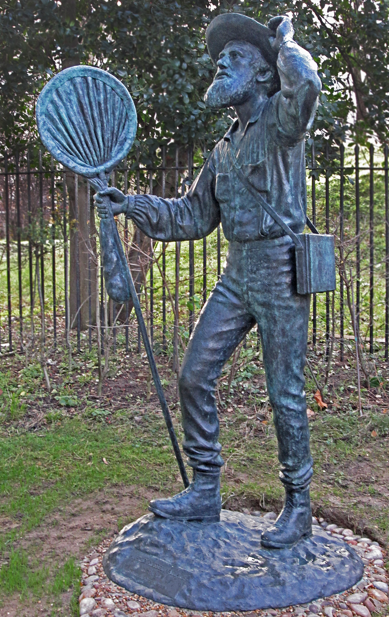 Statue in bronze of naturalist Alfred Russel Wallace (1823-1913) by Anthony Smith. He is looking up at a bronze model of a Wallace's golden birdwing butterfly (Ornithoptera croesus). The statue was commissioned by the Wallace Memorial Fund and was given to the London Natural History Museum, where it was unveiled by Sir David Attenborough on November 7th 2013 - the 100th anniversary of Wallace's death.