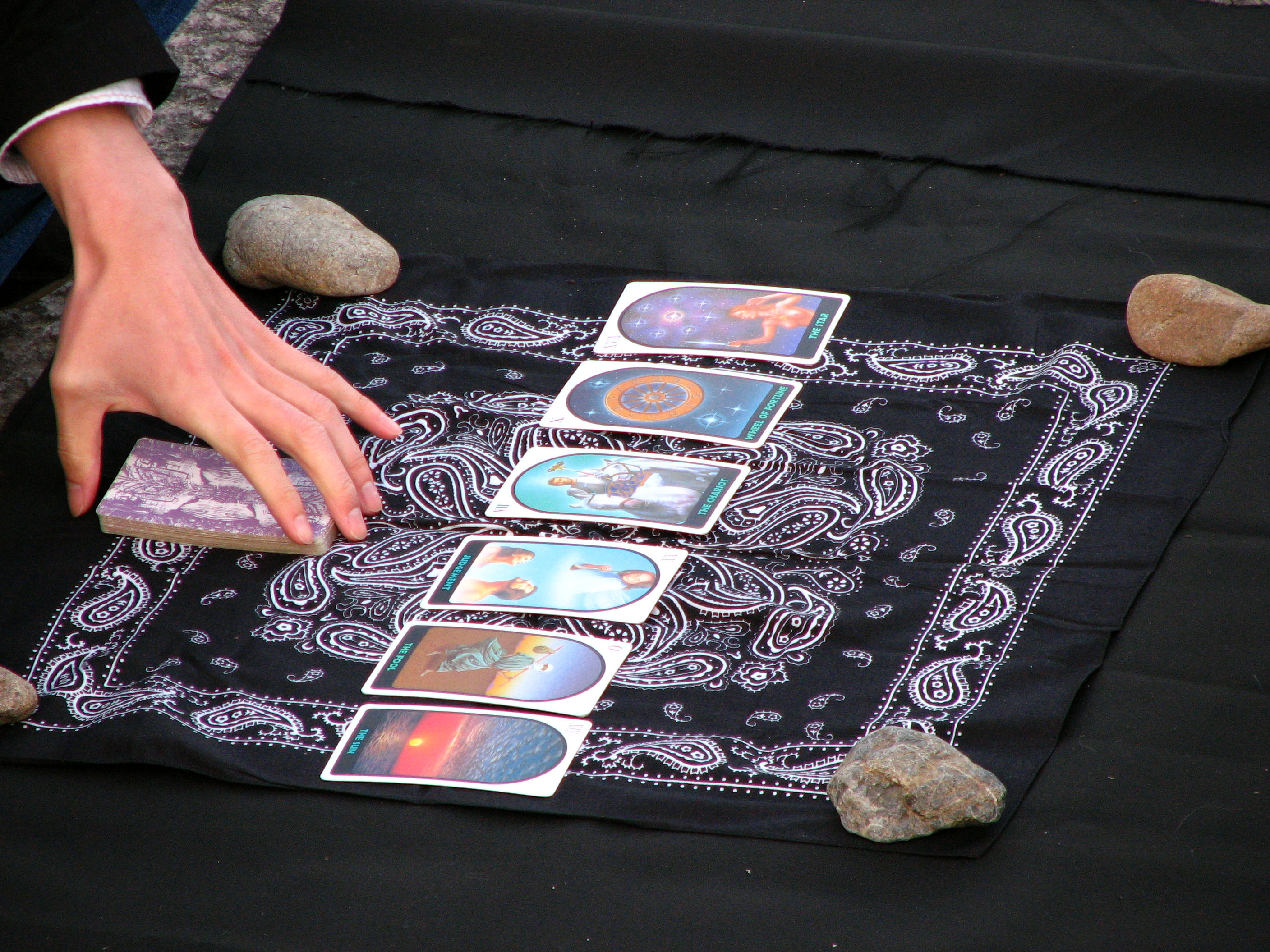 Tarot reader.jpg English: Looks like he's using all Major Arcana for his readings. Either that, or his customer is going to have a VERY interesting