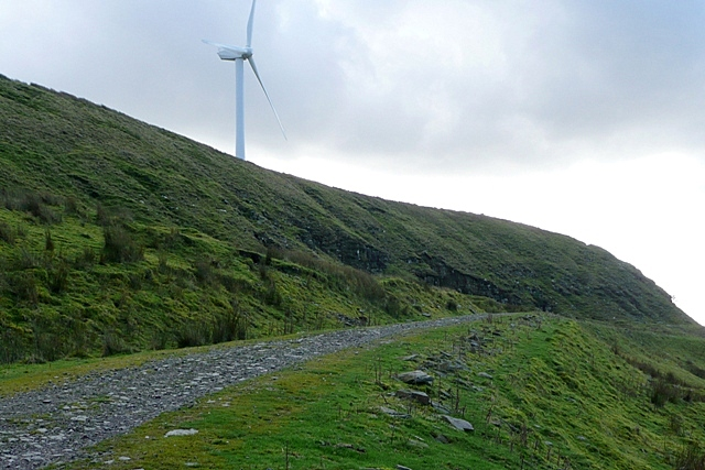 Bridleway at Ffynnon Oer Heading south the Ffynnon Oer crags and windturbines are to the left.