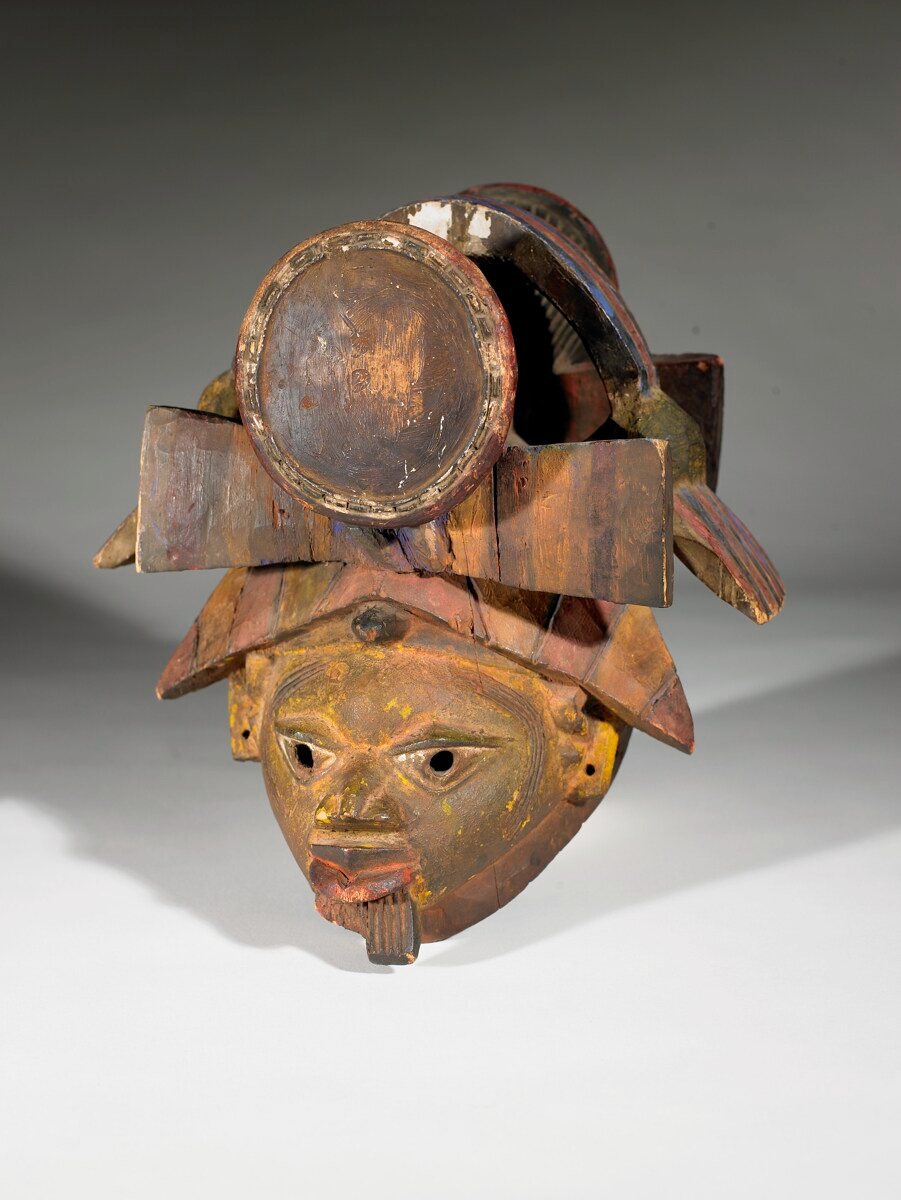 gelede mask This mask called gelede, is part of the rituals of a male initiation society, celebrated before the rainy season the mask represents a woman, with a posit.