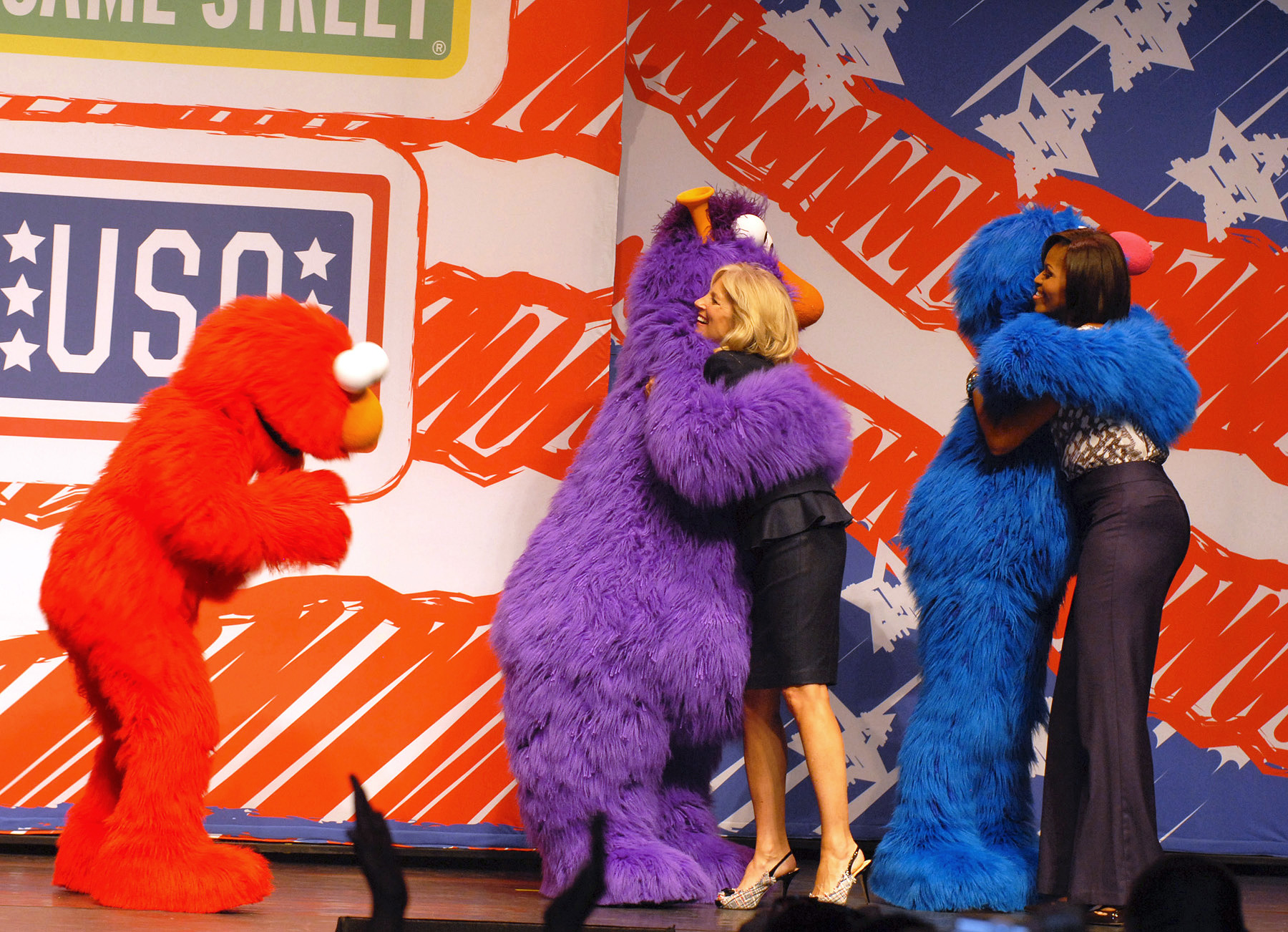 file jill biden and michelle obama greet sesame street muppets file jill biden and michelle obama greet sesame street muppets telly and grover while elmo