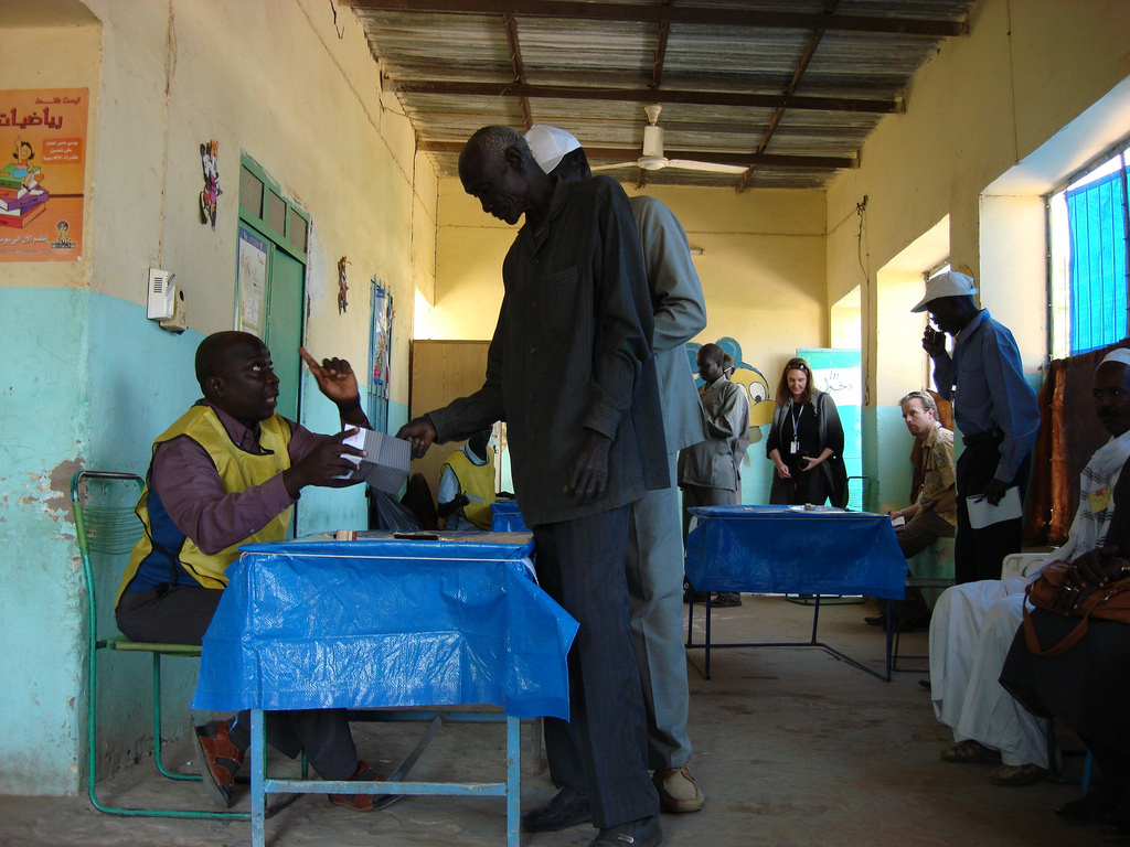 Poll worker explains voting process in southern Sudan referendum.jpg