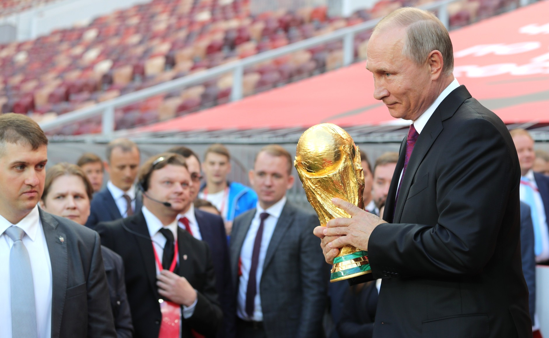Russian President Vladimiar Putin holds the FIFA World Cup Trophy by the press service of the Russian President
