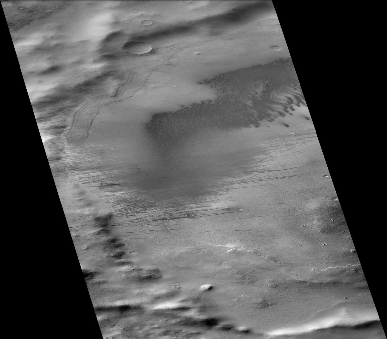 Biachini Crater, as seen by CTX camera (on Mars Reconnaissance Orbiter). Dust devil tracks and dunes are visible on the floor. The narrow, dark lines are dust devil tracks.