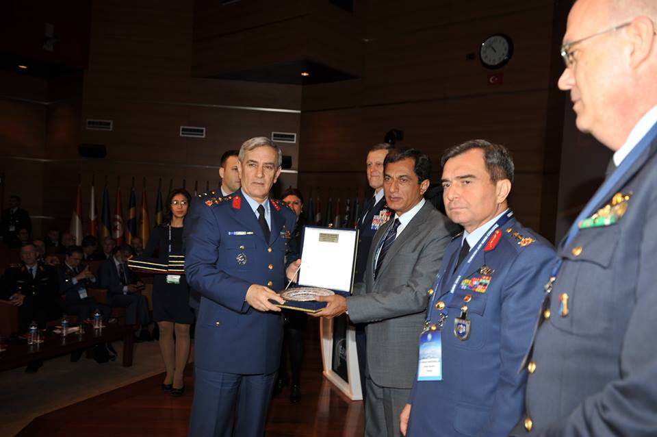 Air Commodore Kaiser Tufail receiving a memento from Commander of the Turkish Air Force General Akin Ozturk.jpg