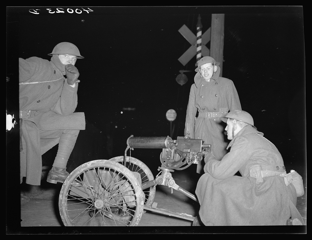 National Guardsmen with machine guns overlooking Chevrolet factories number nine and number four. Flint Sit-Down Strike National Guard.jpg