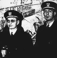 Two men in naval uniform