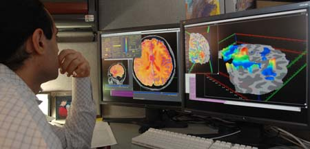 Researcher checking fMRI images - By NIMH - US Department of Health and Human Services: National Institute of Mental Health, Public Domain