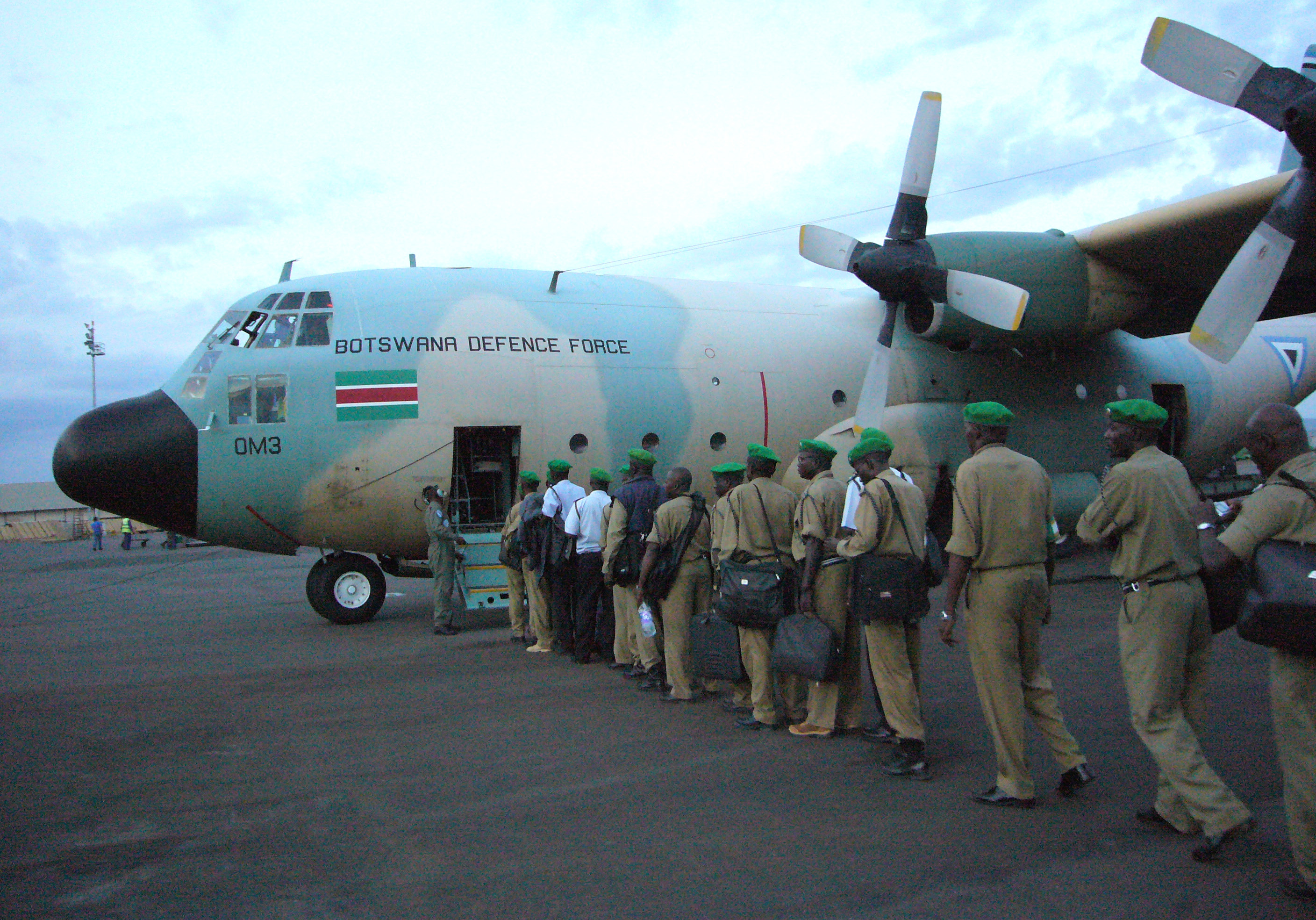 Ugandan civil police board BDF Air Wing C-130 in Kigali 2006-09-26.jpg
