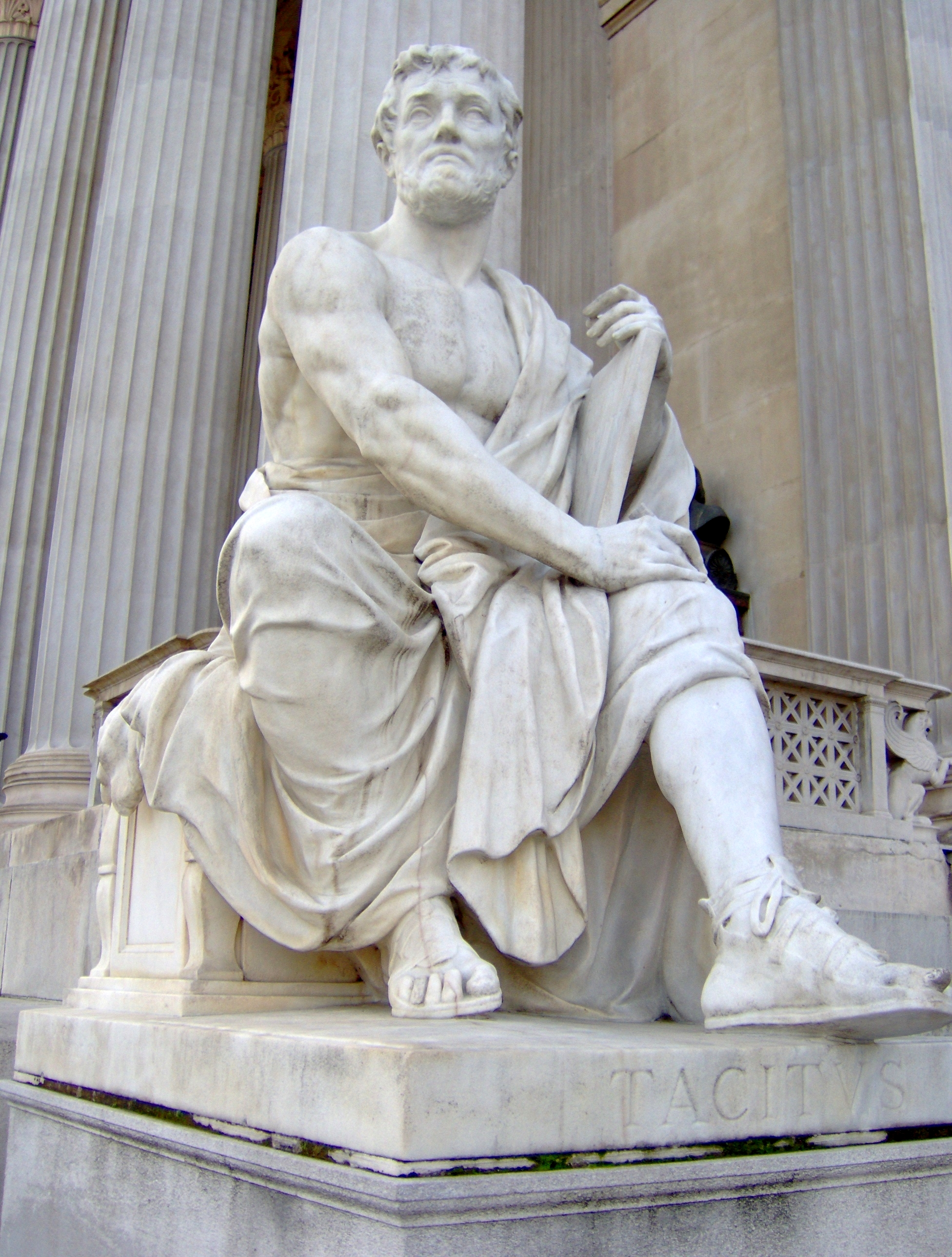 {{centre|Modern statue representing ''Tacitus''<br />outside the [[Austrian Parliament Building]]}}