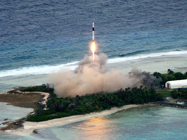 SpaceX Falcon 1 Flight 5 photographed from the air shortly after launch as it rises over Omelek Island, Marshall Islands.