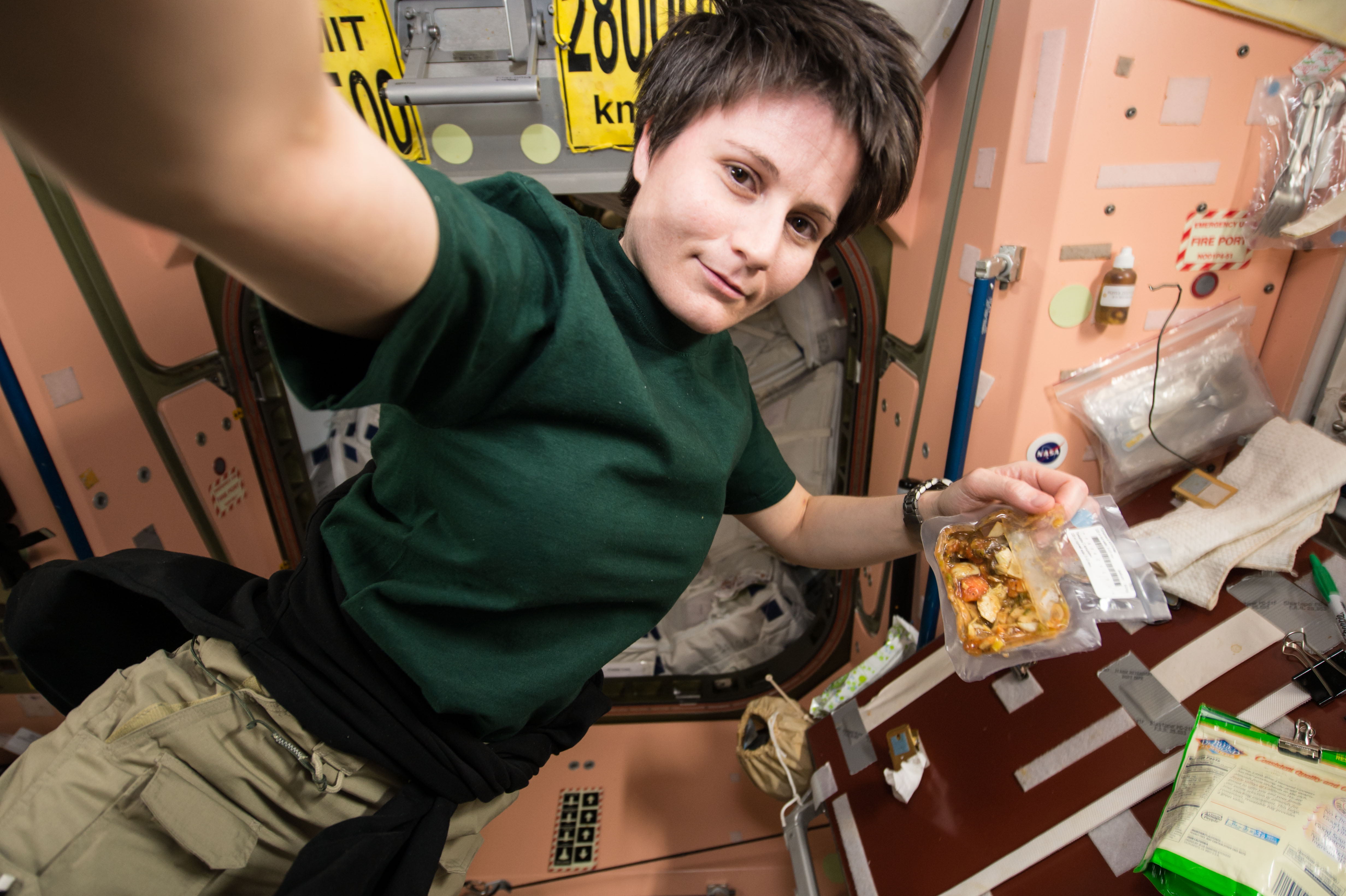 Fileiss 42 Samantha Cristoforetti Prepares To Eat A Snack In The