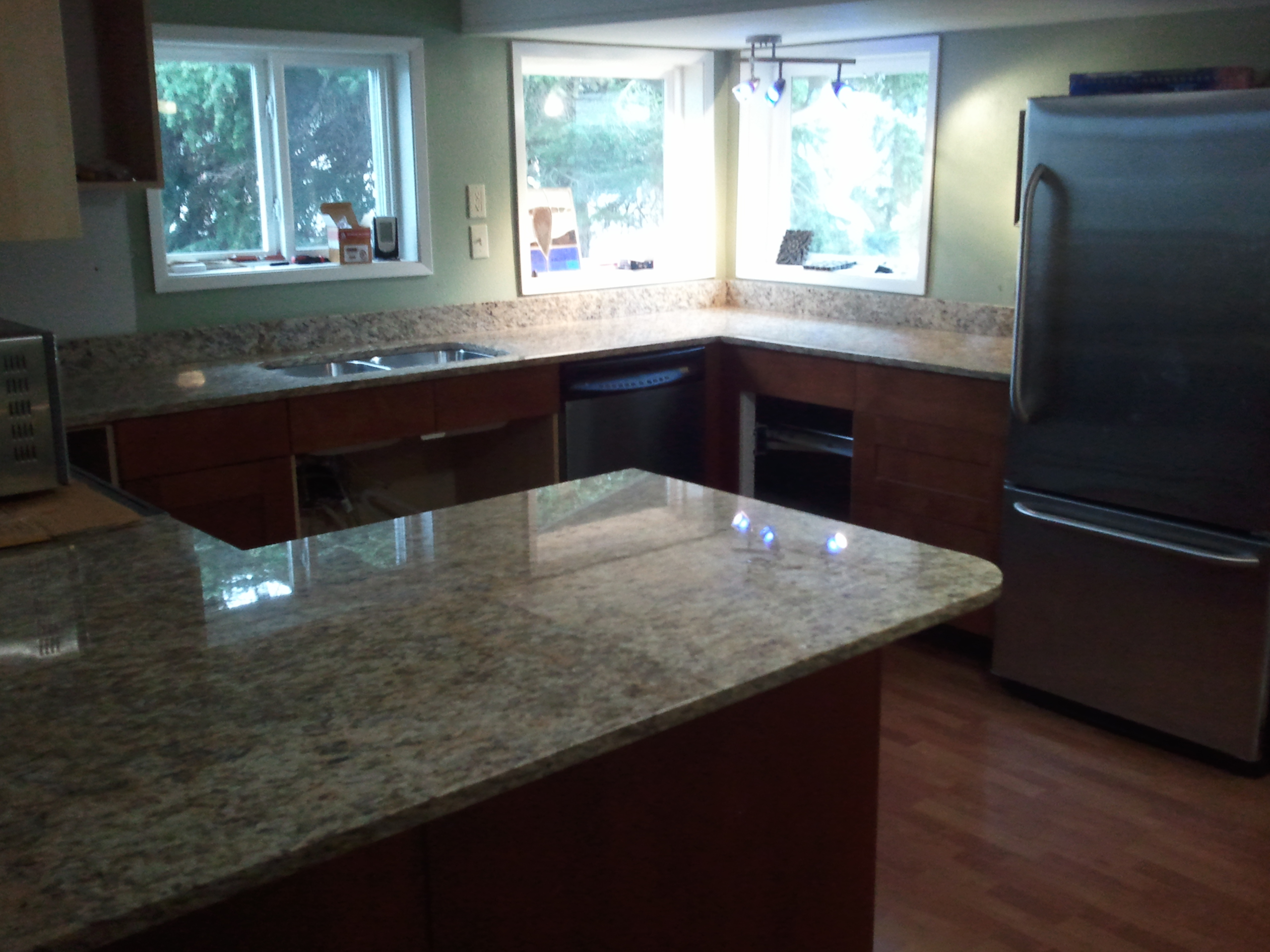 Which granite countertop color goes best with your kitchen combo?